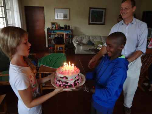 Lydia and Moses hold Lydia's early birthday cake