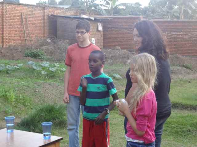 """Lydia and Moses, with their teacher Julie at """"Harvest Day"""""""