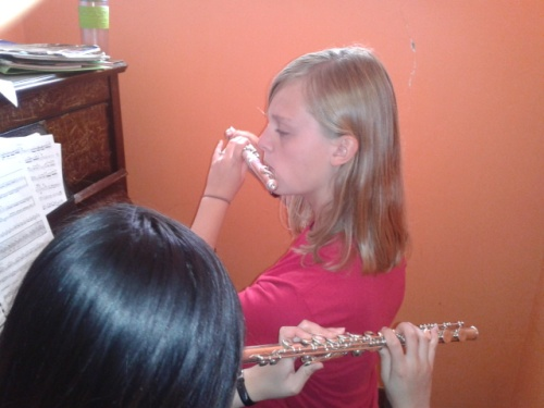 Hannah practices the flute
