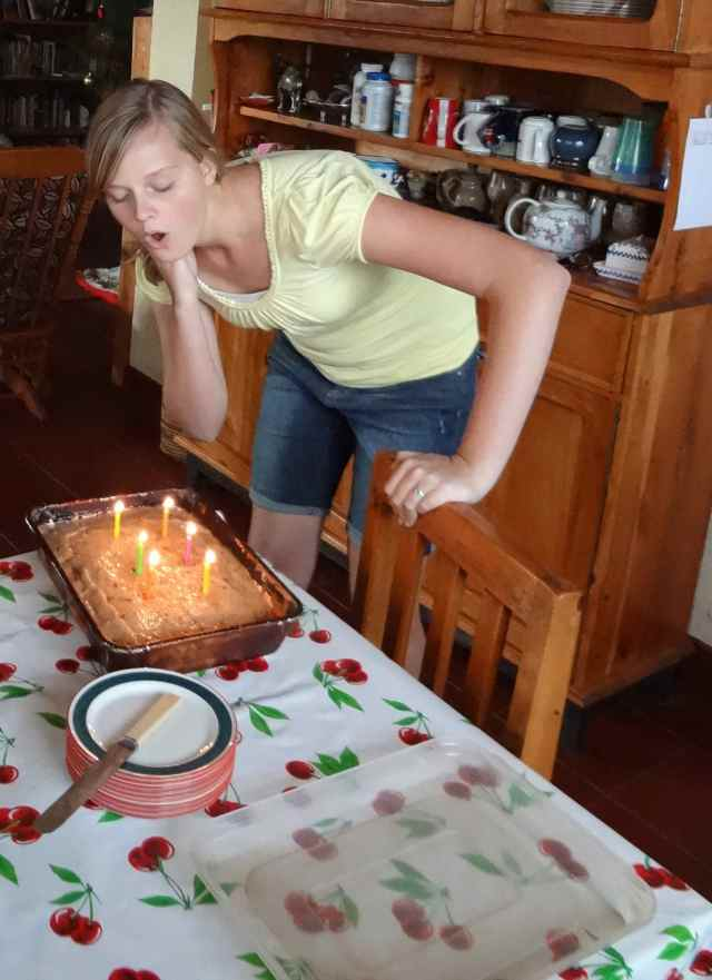 Hannah blows out the candles.