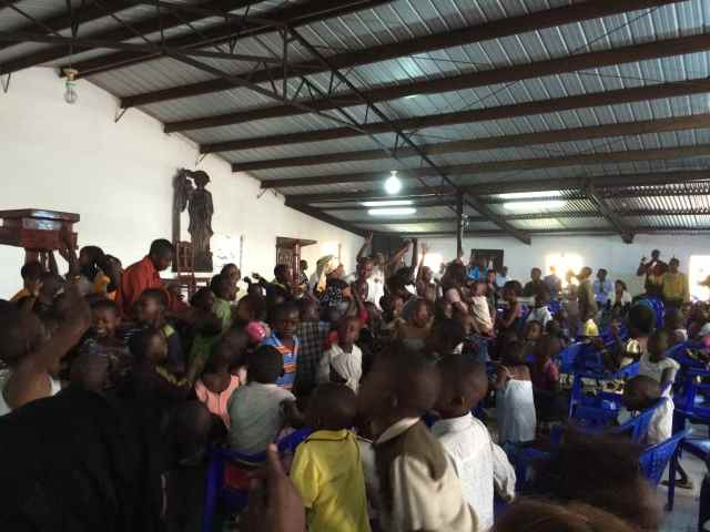 Worshipping on Sunday in the church HealAfrica founded