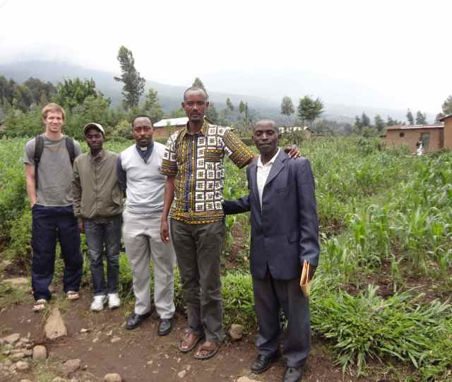 Our scouting visit to the Kagano area, where we are hoping to help build a church. You can see some of the volcanoes in the mist behind us.
