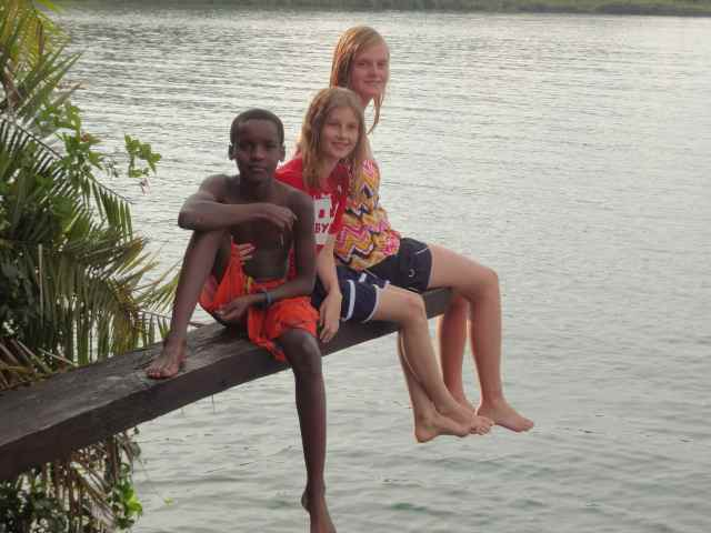 The children are relaxing on the diving board